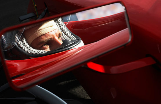 Racecar Driver's Reflection in Side-View Mirror --- Image by � Randy Faris/Corbis